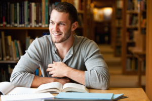College man in library